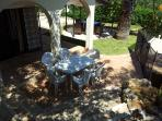 The garden has many seating and eating areas in the sun or shade