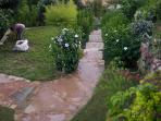 Terraced subtropical Garden with Gardner