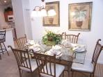 View of the formal dining area - table set for 6
