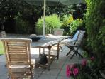 Private, secure garden with sun-loungers and parasol - a sun trap!