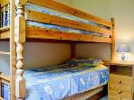 Single bedroom with bed double stacked to form bunks