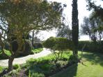 A garden path leading from Beachcomber entrance gate towards the car park within Gated ground.