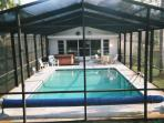 Rear view of private pool & hot tub home