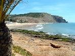 A short walk to the sandy sheltered Blue Flag Beach in Luz
