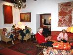 Guests relaxing in Westcove House Sitting Room