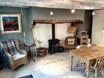 Huge well equipped kitchen with dining table seating 6, log-burner and comfy chairs
