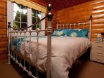 Pretty iron framed double bed
