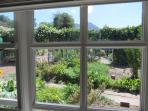 View of kitchen garden and Helderberg mountains from cottage