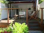 Rear deck leading from open plan kitchen, overlooking courtyard garden