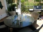 Rear terrace with table and chairs for al fresco dining