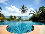 Panoramic views from living room across Chalong Bay with infinity pool