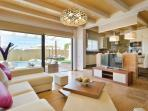 Bright, open plan living room and fully equipped modern kitchen