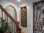 Master bedroom door from the corridor, with bookshelves