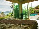 Poolside bedroom, queen size bed, en-suite bathroom with spectacular views