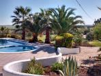 4.5 hectares of private landscaped grounds and gardens set in an Alentejo backdrop