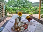 enjoying breakfast at alghero cottages blualghero