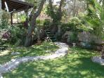 Beautifully maintained gardens contribute to the peace and tranquility of Oak Tree Apartment.