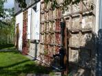 Side of house and Victorian hand pump