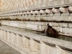 The mysterious Fountain of the 99 Spouts in Abruzzo's capital city L'Aquila