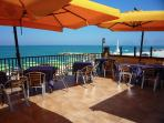 The perfect place for a summer lunch - under a shady umbrella at the seaside