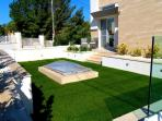 Sunny terrace with turf
