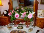 Romantic James Galway roses from the house garden, sit sweetly on Granny's old dressing table.