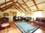 Large Lounge, with log burner, large TV, DVD player. Games room includes football table, dart board.
