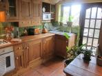 Character Kitchen - modern appliances, country-style units, terracotta floor tiles