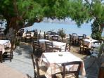Tavernas next to the sea in the village.