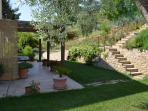 The garden and steps up to the pool