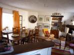 View from kitchen to dinning area. Open plan friendly and warm. Extendable table. Good 1 one or 6+