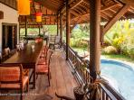 The wooden balcony and its dining area, first floor of our Khmer Villa