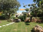 View from extended garden across to pool and trullo