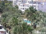 View of Communal pool for the complex from the back balcony