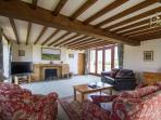 A large large sitting room with great views over the valley