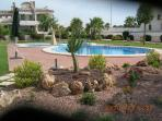 Pool and gardens from  rear of bungalow.