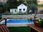 Swimming pool and authentic Dalmatian fireplace cottage