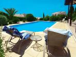 Patio & Swimming Pool with distant Sea View