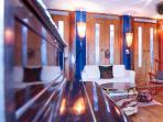 living room, with doors to solarium