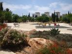 Watch the children play in the play area of Greco Mare