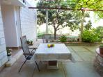 Outside terrace with a table and chairs where you can enjoy your meals