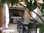 bbq and a comfortable table for six persons