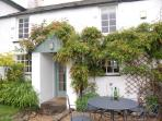 Original cottage front and patio with private walled garden