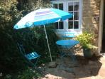 Enjoy a glass of wine on a summers day in the pretty garden