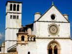 Assisi's famous St. Francis Basilica with Giotto's frescoes awaits.