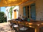 Enjoy dining on the Farmhouse's shady terrace