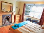 Super king-size double bed with fireplace, wood supplied