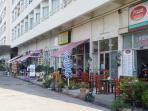 There are plenty of Shops, Restaurants, Massage Shops etc, on the Ground Floor of the Complex.