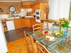 Modern kitchen, very well equipped with dozens of kitchen utensils, crockery and glassware