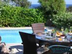 The outdoor area offers breathtaking views of the Mediterranean and Cape Greco National Park
